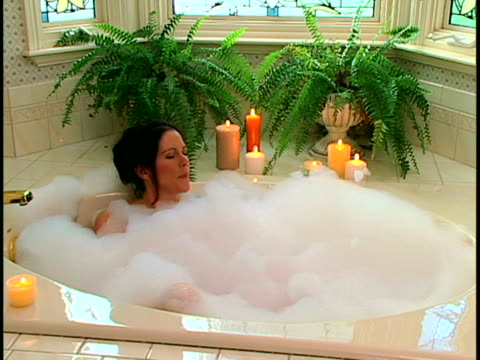 woman in bubble bath - bubble bath stock videos and b-roll footage