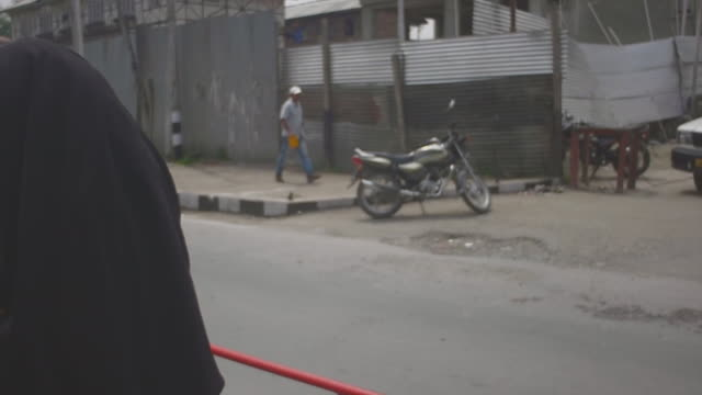 woman in burka on a motorbike - burka stock videos and b-roll footage