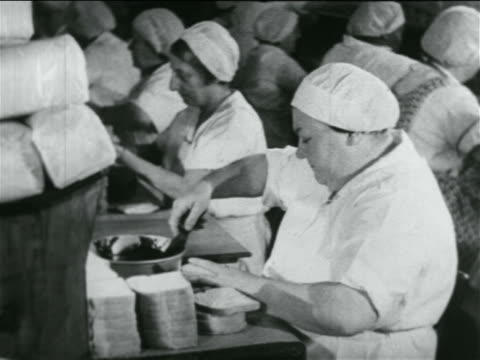 b/w 1934 woman in cap making sandwiches in school lunch kitchen in wpa project / documentary - cafeteria worker stock videos and b-roll footage