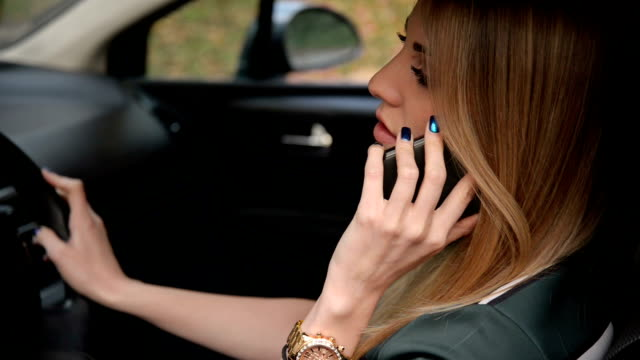 Woman in car talking on the phone