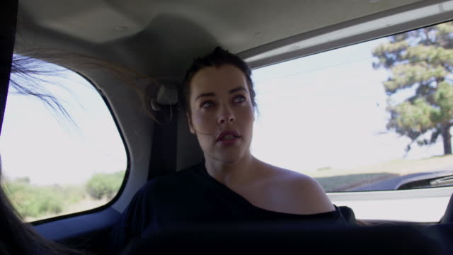 woman in car - sedile del passeggero video stock e b–roll