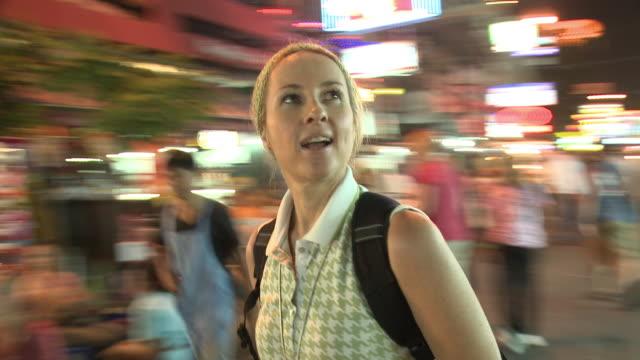 CU DS Woman in city street at night, Bangkok, Thailand