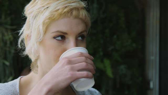 woman in coffee shop - nose ring stock videos & royalty-free footage