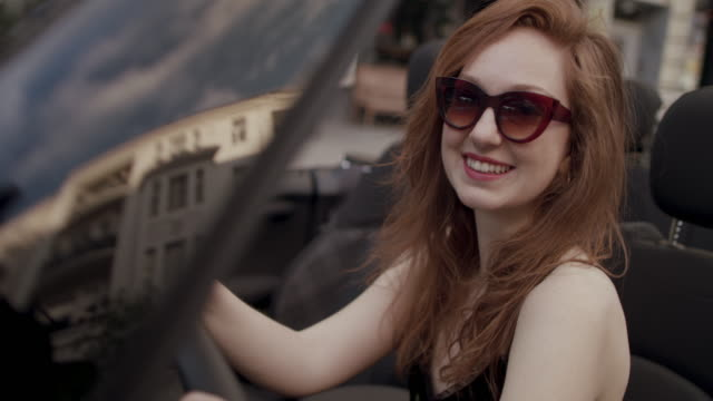 woman in convertible, smiling - translucent stock videos and b-roll footage