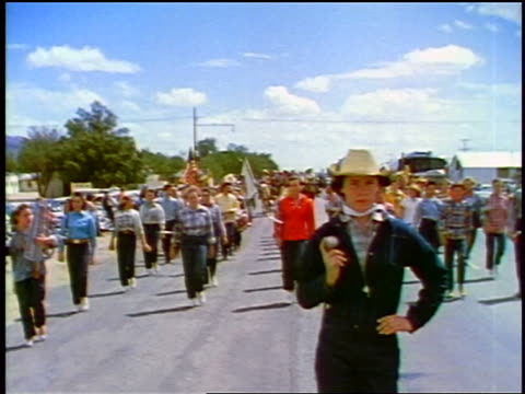 1957 woman in cowboy hat carrying baton leading crowd in parade / feature - cowboy hat stock videos & royalty-free footage