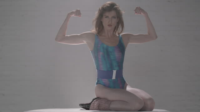 woman in dance apparel flexing her arms - bicep stock videos and b-roll footage