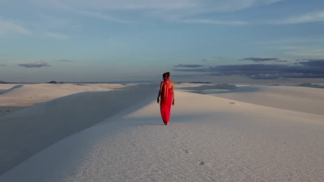 WS PAN Woman in dress walking in white sands / White Sands, New Mexico, USA