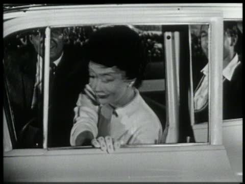 b/w 1959 woman in drivers seat slamming door of new chevrolet - 1959 stock-videos und b-roll-filmmaterial