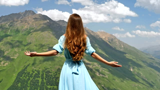 woman in elegant gown posing in mountains - dress stock videos & royalty-free footage