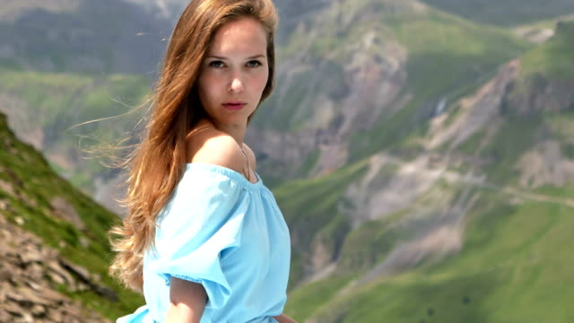 woman in elegant gown posing in mountains - long hair stock videos and b-roll footage