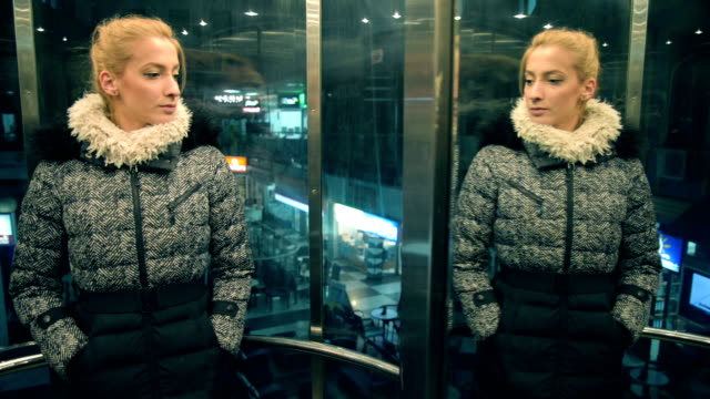 woman in elevator. - mirror object stock videos & royalty-free footage