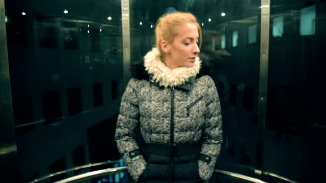 woman in elevator. - lift stock videos & royalty-free footage