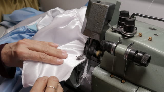 cu woman in factory sewing - art and craft product stock videos & royalty-free footage