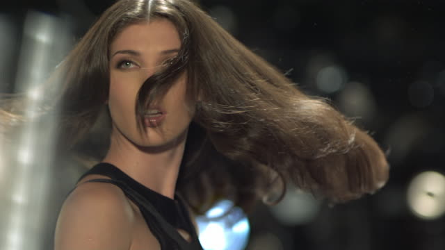 woman in fashion show/red carpet event tossing her glamorous hair while flashes go off. - fashion model stock videos and b-roll footage