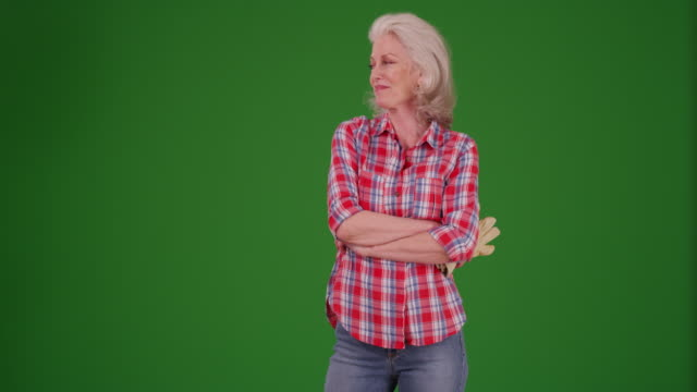 woman in flannel shirt standing with arms crossed in front yard on greenscreen - gardening glove stock videos & royalty-free footage