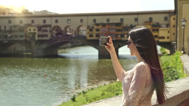 woman in florence, photographing ponte vecchio - ponte stock videos & royalty-free footage