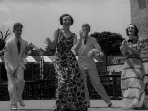 "B/W 1937 woman in flowered dress dancing ""Big Apple"" in circle outdoors / Washington, DC / newsreel"