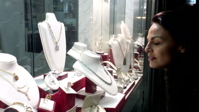 woman in front of jewelry store. - window display stock videos & royalty-free footage
