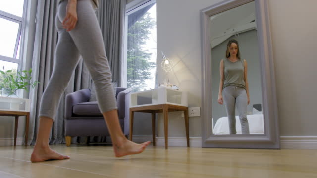 woman in front of mirror - sitting on floor stock videos and b-roll footage