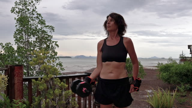 woman in garden lifting dumbells home exercising outdoor - hand weight stock videos & royalty-free footage