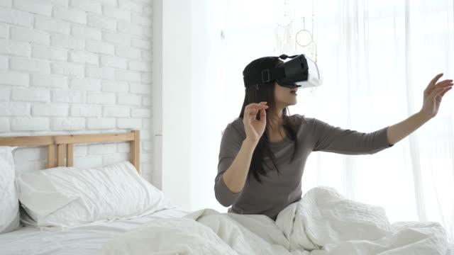 SLO MO Woman in glasses of virtual reality at home