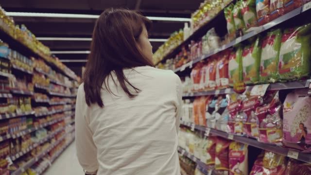 woman in grocery store - choice stock videos & royalty-free footage