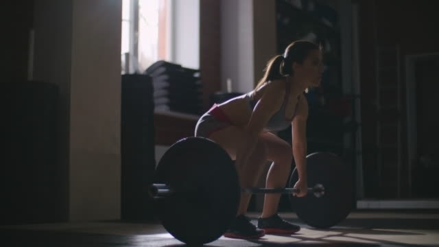 Woman in gym weightlifting