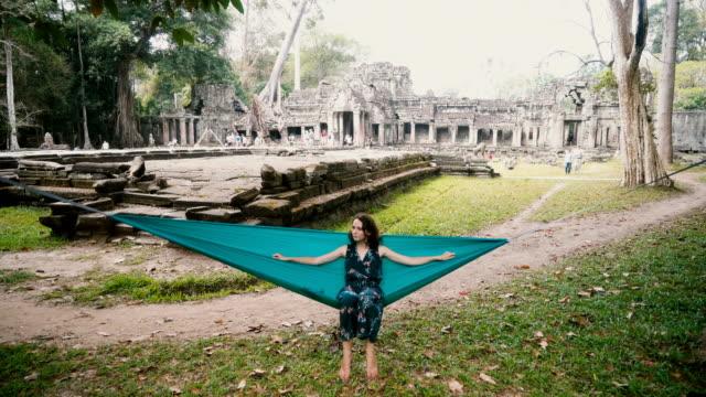 woman in hammock in angkor  wat - angkor stock videos and b-roll footage