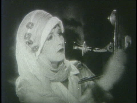 b/w 1928 woman in hat (vera steadman) cranking wall telephone + talking - machine part stock videos & royalty-free footage