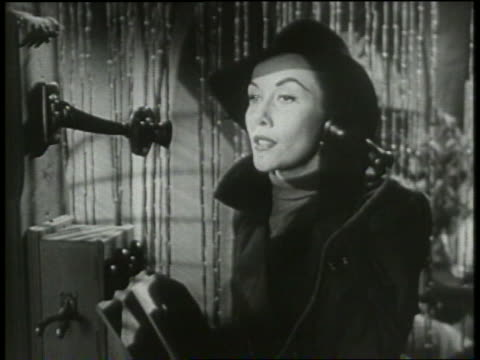 b/w 1950 woman in hat / femme fatale talking on pay telephone - femme fatale stock videos and b-roll footage