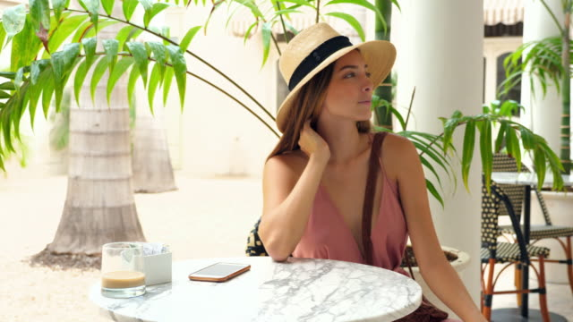 r/f woman in hat taking selfie while sitting in outdoor cafe - erinnerung stock-videos und b-roll-filmmaterial