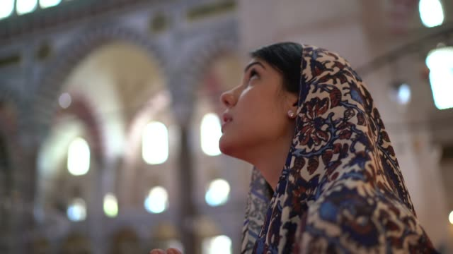 woman in headscarf praying in a mosque, istambul, turkey - islam stock videos & royalty-free footage