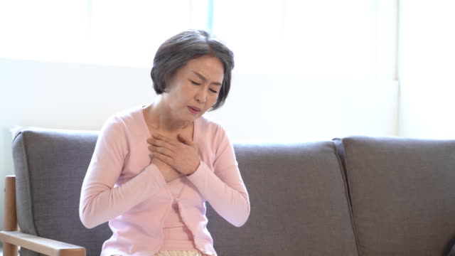 woman in her sixties suffering from chest pain - chest stock videos & royalty-free footage