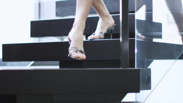 cu ts woman in high heels walking down staircase / aspen, colorado, united states - high heels stairs stock videos & royalty-free footage