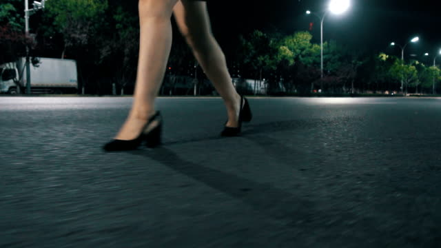 woman in high heels walking on street at night - human leg stock videos & royalty-free footage