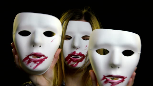 woman in horror mask dancing and holding two masks - tragedy mask stock videos & royalty-free footage