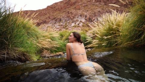 woman in hot spring in atacama desert - geyser stock videos & royalty-free footage