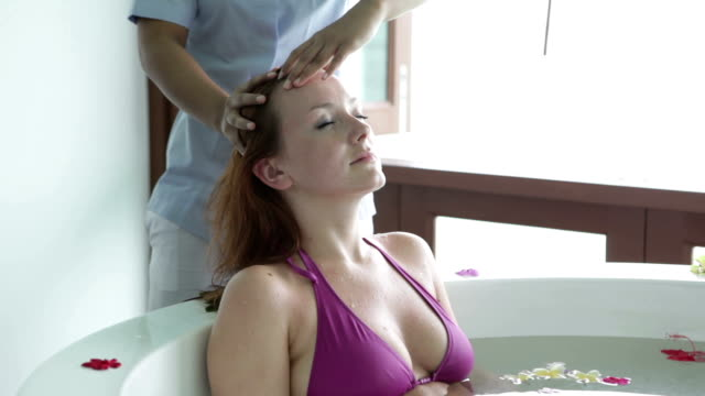 woman in hot tub during head massage