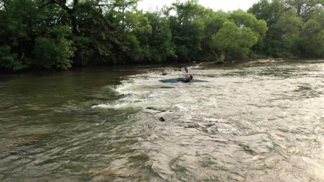 woman in kayak having some problems on river - kayaking stock videos & royalty-free footage