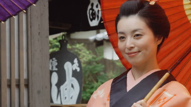 woman in kimono posing with parasol - kimono stock videos & royalty-free footage