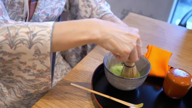 woman in kimono preparing tea at japanese tea ceremony, sado - traditional ceremony stock videos & royalty-free footage
