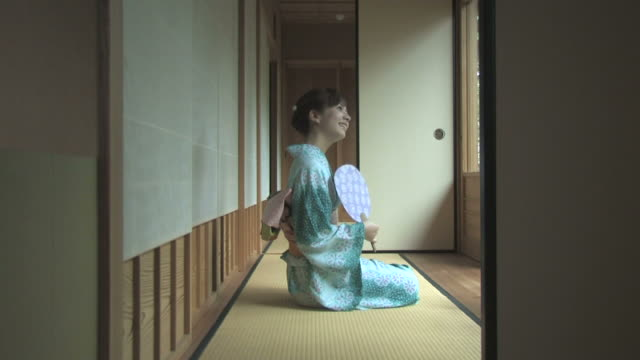 woman in kimono relaxing in traditional japanese room - kimono stock videos & royalty-free footage
