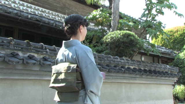 woman in kimono walking - kimono stock videos & royalty-free footage