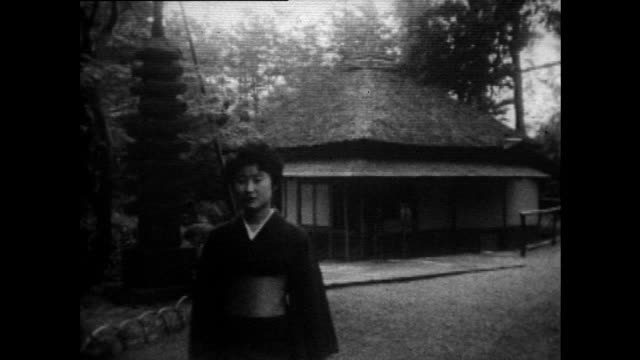 woman in kimono walks towards camera; 1958 - bbc archive stock-videos und b-roll-filmmaterial