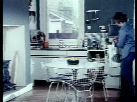 Woman in kitchen, archive