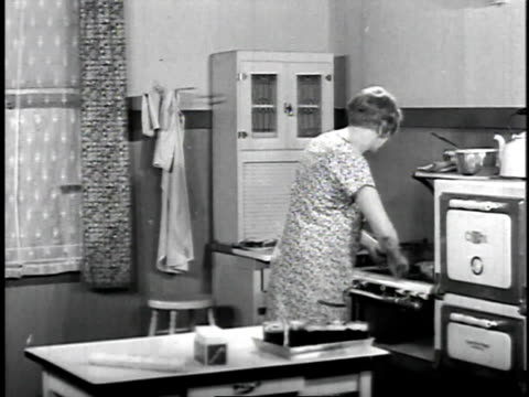 1929 montage woman in kitchen heating paraffin and pouring it into jars / united states - gelatin stock videos and b-roll footage