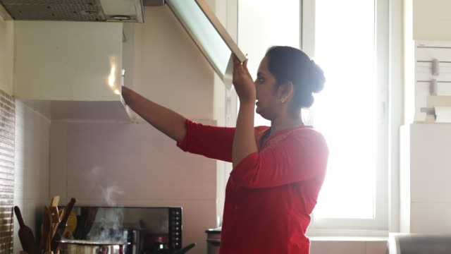 woman in kitchen - only mature women stock videos & royalty-free footage