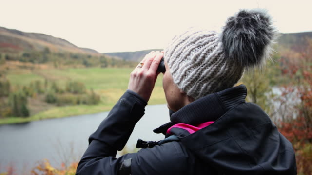 woman in landscape - binoculars stock videos & royalty-free footage