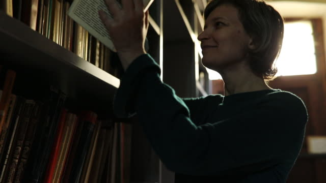 woman in library - bookshelf stock videos & royalty-free footage