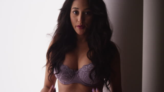 woman in lingerie standing and playing with hair - bra stock videos & royalty-free footage